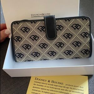 Dooney & Bourke wallet, new in box. Never used